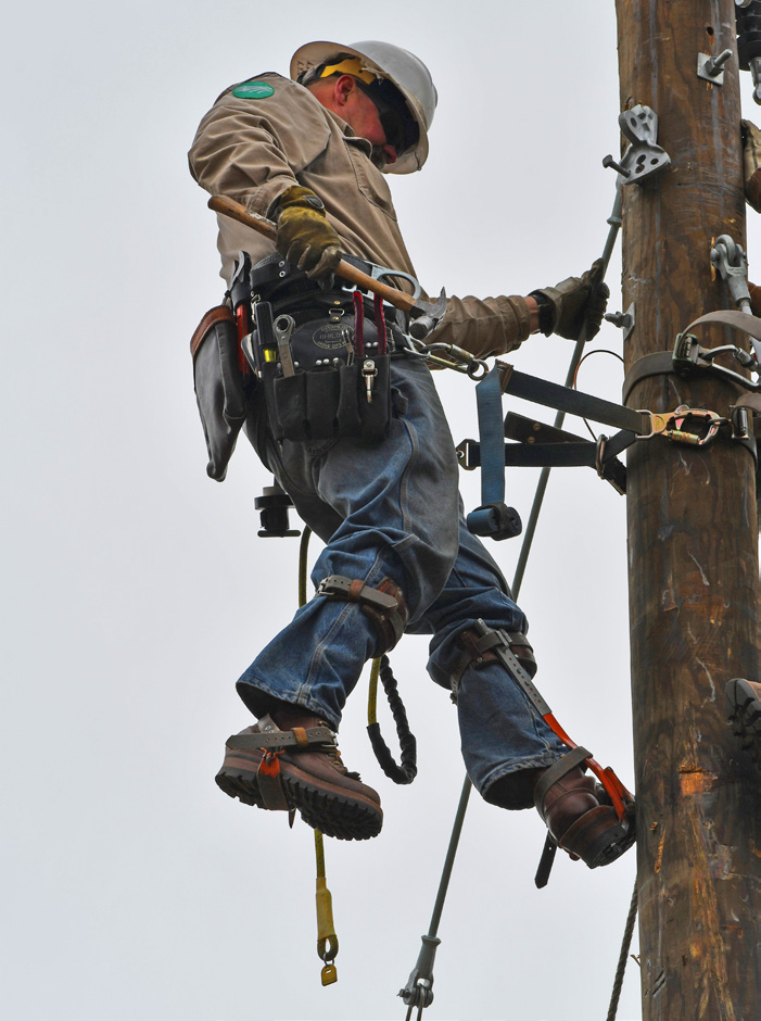 Lineworker on a pole