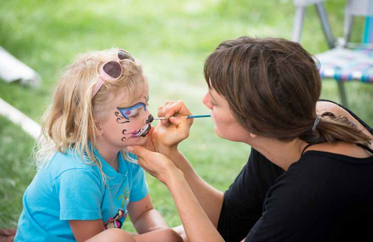Artist painting a little girl's face