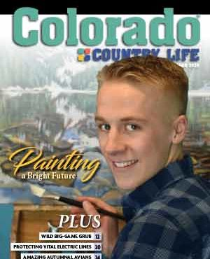 Young boy painting on the cover of Colorado Country Life October 2020