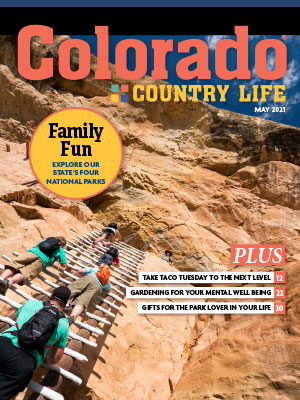 kids climbing up mountain on May colorado Country Life magazine cover