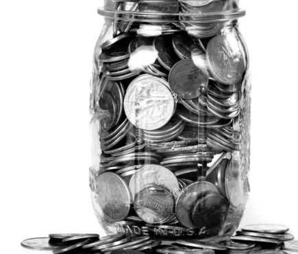 jar overflowing with coins
