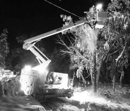 SDCEA crews routinely work in very challenging conditions, seen in this image taken during a late-summer snowstorm September 8 and 9. Tree mitigation will lessen the number of outages and the time it takes to restore power.