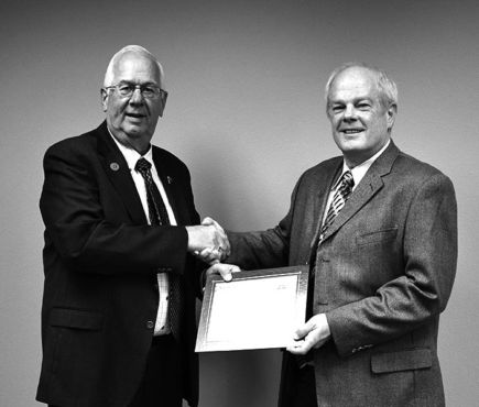 SDCEA director Dan Daly (right) was recently recognized for his achievement by SDCEA Board Chair Joe Redetzke (left).