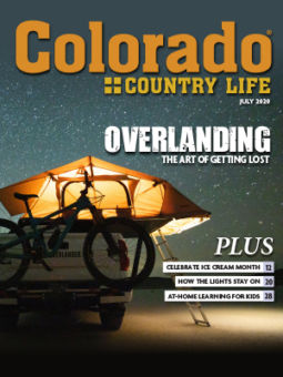 A bike and tent on a car, at night under the stars. Colorado Country Life July 2020. Overlanding, the art of getting lost. Plus, celebrate ice cream month, pg. 12. How the lights stay on, pg. 20. At-home learning for kids, pg. 28.