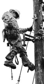 Lineman working on pole
