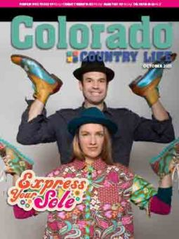 man and woman with shoes on their hands on october 2021 colorado country life cover
