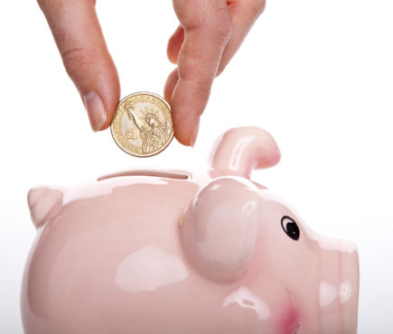 coin being put into piggy bank