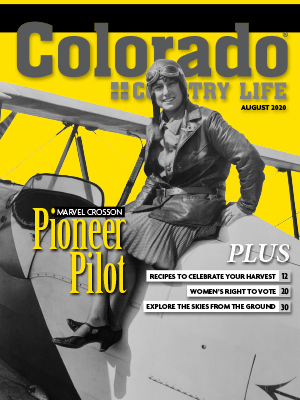 Woman pilot sitting on top of her plane. Colorado Country Life August 2020 cover issue. Marvel Crosson Pioneer Pilot. Plus Recipes to celebrate your harvest, 12. Women's right to vote, 20. Explore the skies from the ground, 30.