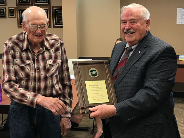 Howard & Don – Howard Eggleston (L) received a plaque from Board President Don Kaufman (R) recognizing his many years of service to Sangre de Cristo Electric Association, Inc.