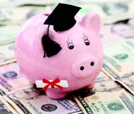 Piggy bank wearing graduate cap