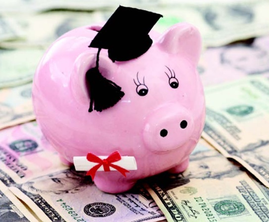 Piggy bank wearing graduate cap
